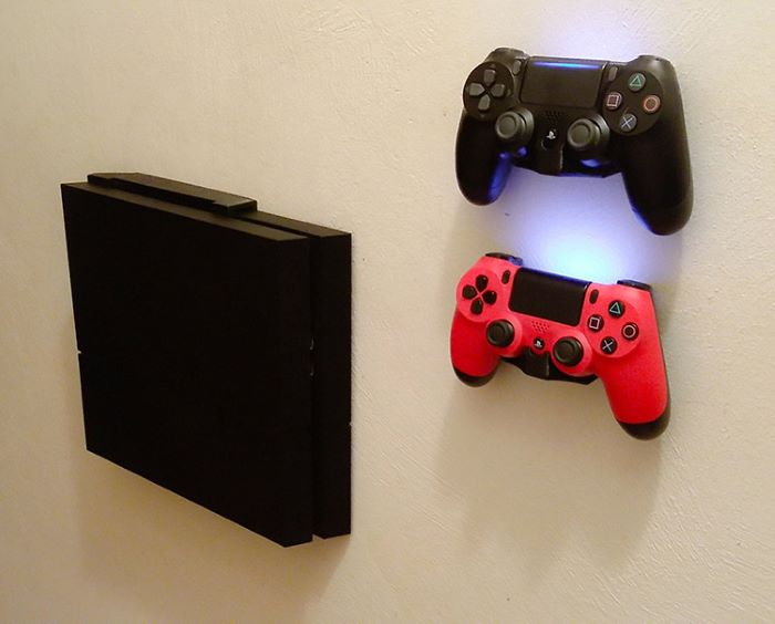 Wall mount brackets for video controller and console